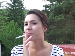 Beauty smokes before she masturbates doused on cam