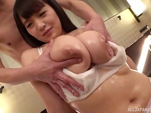 Busty and oiled Japanese ramming a fat friend's penis on high the bed