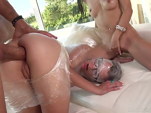 Plastic wrap porn scene featuring a handful of nerdy girls approximately glasses